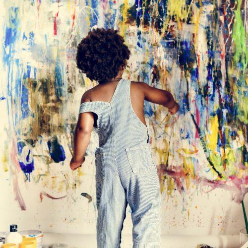 black-kid-enjoying-his-painting.jpg